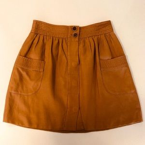 Pleated button-front mini skirt with pockets